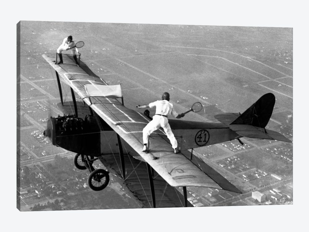 Playing Tennis on a Biplane in 1925 by Unknown Artist 1-piece Canvas Wall Art
