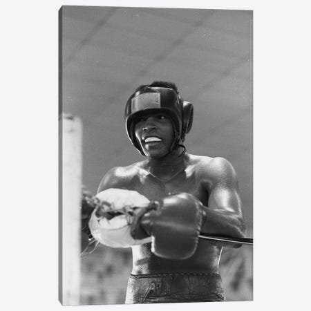 Head Gear Wearing Muhammad Ali In The Corner Between Rounds Canvas Print #ALI12} by Muhammad Ali Enterprises Canvas Art Print