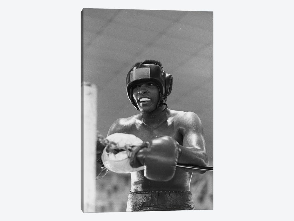 Head Gear Wearing Muhammad Ali In The Corner Between Rounds by Muhammad Ali Enterprises 1-piece Canvas Wall Art