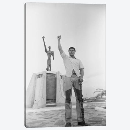 Muhammad Ali Posing In Front Of The Le Militant Statue, Kinshasa, Zaire Canvas Print #ALI47} by Muhammad Ali Enterprises Art Print