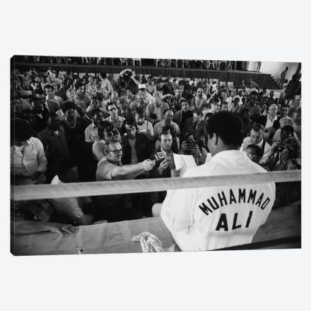 Muhammad Ali Sitting On The Side Of A Ring Talking To The Press Canvas Print #ALI51} by Muhammad Ali Enterprises Art Print