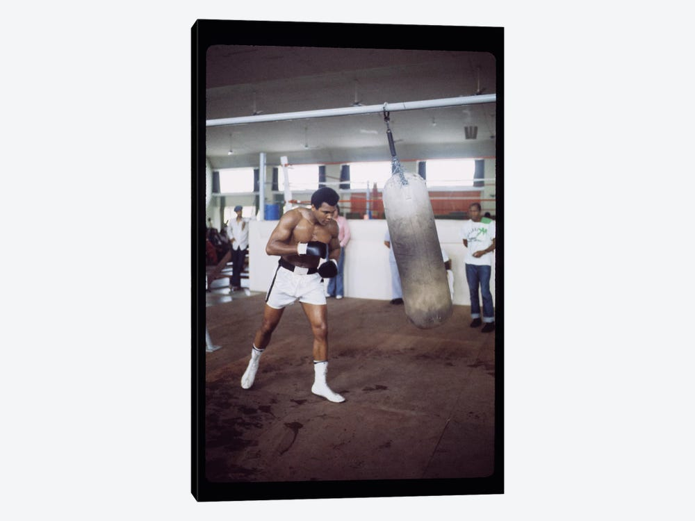 Punching Bag Work At Rumble In The Jungle™ Training Session by Muhammad Ali Enterprises 1-piece Art Print