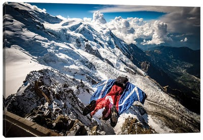 A Wingsuiter Base Jumps From Aiguille du Midi Toward Glacier des Bossons, Chamonix, France Canvas Art Print
