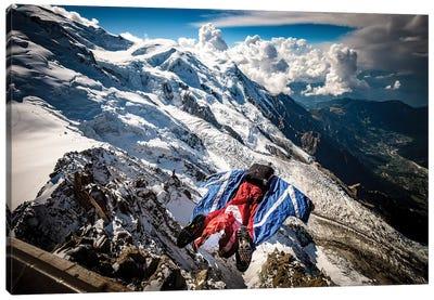 A Wingsuiter Base Jumps From Aiguille du Midi Toward Glacier des Bossons, Chamonix, France Canvas Art Print