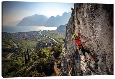 A Climber Above The Town Of Arco And Lago di Garda, Italy Canvas Art Print