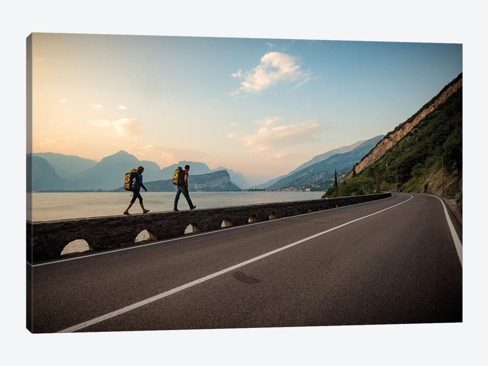 Two Climbers Walk Home Next To A Road And Lago di Gardo, Arco, Trentino, Italy by Alex Buisse 1-piece Canvas Art