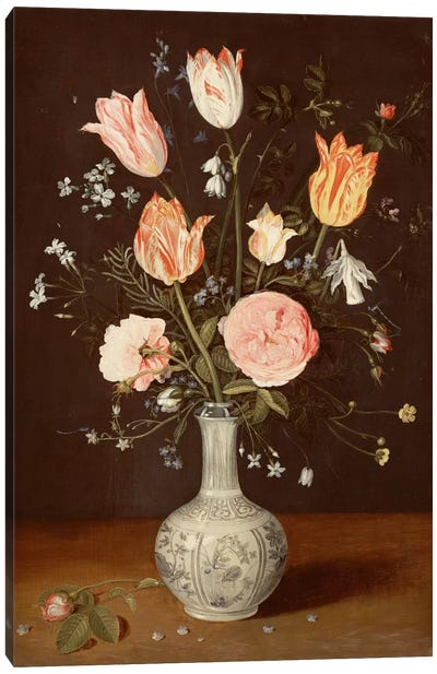 Tulips, roses, forget-me-nots and other flowers in a late Ming blue and white vase  Canvas Art Print