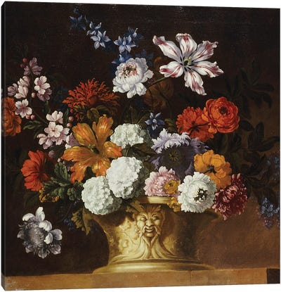 Tulips, snowballs and other flowers in a sculpted urn on a ledge  Canvas Art Print