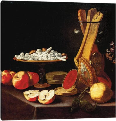 Sweets on a tazza, narcissi in a glass vase, breadsticks in a jar, and apples, jelly and a lemon on a draped table  Canvas Art Print