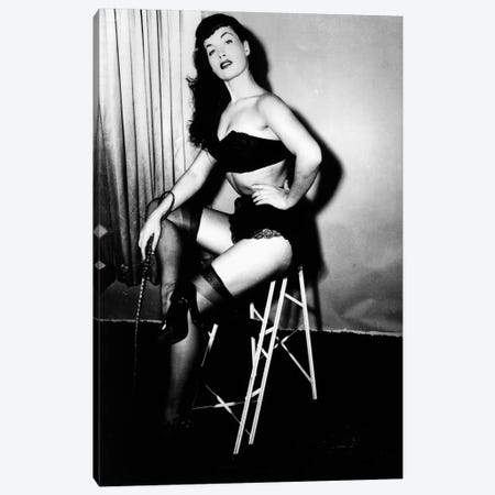 Bettie Page, American model and pin up, c. 1955 Canvas Print #BMN8505} by Rue Des Archives Canvas Wall Art