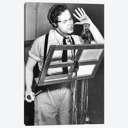 "Orson Welles reading text of ""War of the Worlds"" by HG Wells during CBS radio broadcast in October 1938 Canvas Print #BMN8625} by Rue Des Archives Canvas Print"