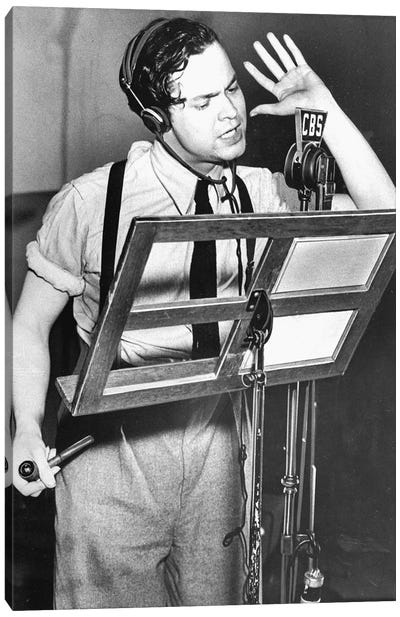 """Orson Welles reading text of """"War of the Worlds"""" by HG Wells during CBS radio broadcast in October 1938 Canvas Art Print"""
