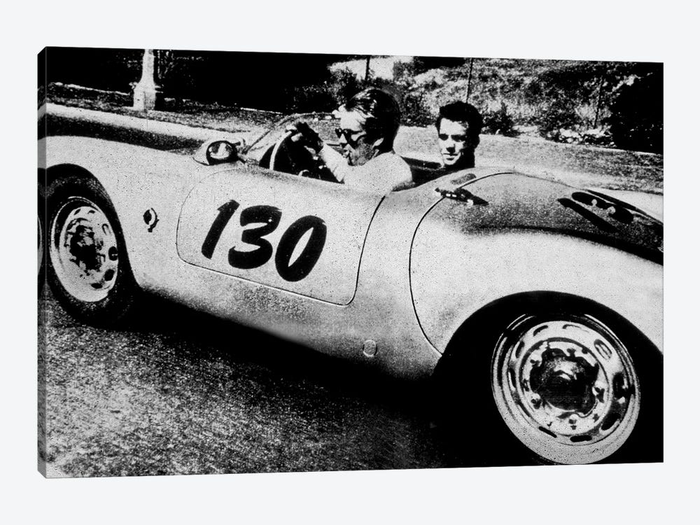 The American Actor James Dean driving his Porsche Spider 550A with Rolf Wutherlich , in 1955 by Rue Des Archives 1-piece Canvas Print