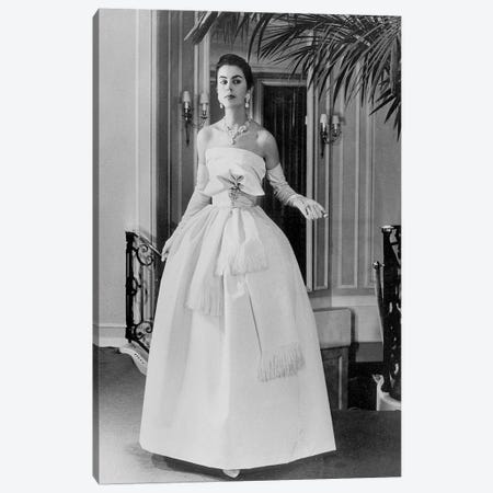 White evening dress by Dior, February 1958 Canvas Print #BMN8655} by Rue Des Archives Canvas Wall Art