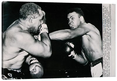 Young Cassius Clay against Archie Moore in the first round. Los Angeles, 15th November 1962  Canvas Art Print