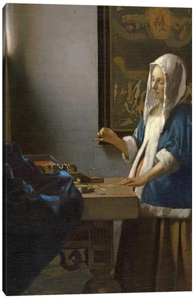 Woman Holding a Balance, c.1664 Canvas Art Print