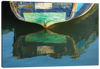 Morocco, Essaouira. An artistic watercolor effect of a wooden boat floating in the harbor. Canvas Art Print