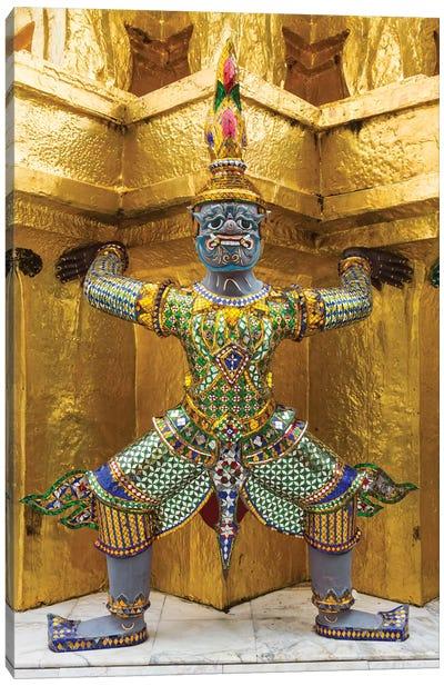 Thailand, Bangkok. Yaksha, demons, guard one of the golden chedi at Wat Phra Kaew. Canvas Art Print