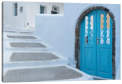Greece, Santorini. Blue door livens up a quiet alley of white-washed homes in Pyrgos. Canvas Art Print