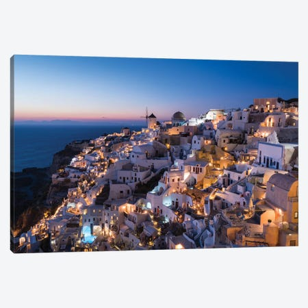 Greece, Santorini. The Village Of Oia Glows In The Post-Sunset Light As The Town'S Lights Add Magic To This Iconic Scene. Canvas Print #BND29} by Brenda Tharp Canvas Art