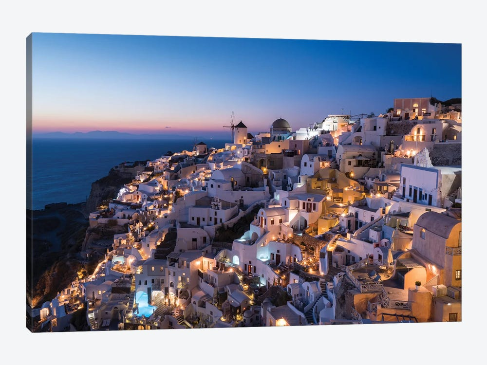 Greece, Santorini. The Village Of Oia Glows In The Post-Sunset Light As The Town'S Lights Add Magic To This Iconic Scene. by Brenda Tharp 1-piece Canvas Print