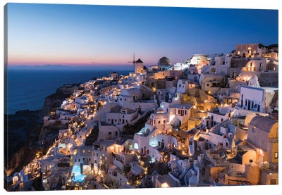 Greece, Santorini. The Village Of Oia Glows In The Post-Sunset Light As The Town'S Lights Add Magic To This Iconic Scene. Canvas Art Print