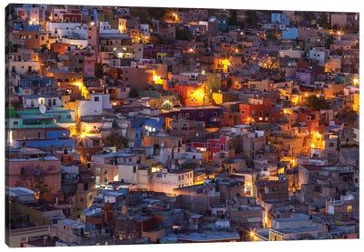 Mexico, Guanajuato. Street lights add ambience to this twilight village scene. Canvas Art Print