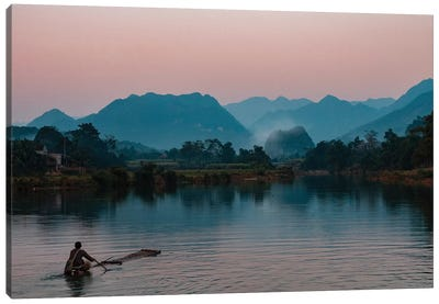 Asia, Vietnam, Pu Luong Nature Reserve. Lone Man Takes Simple Raft Out Onto River For Sunset Cruise. Canvas Art Print