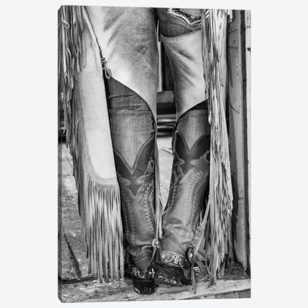 Horse drive in winter on Hideout Ranch, Shell, Wyoming. Cowgirl detail of boots and chaps in doorway of log cabin. Canvas Print #DGU170} by Darrell Gulin Canvas Artwork