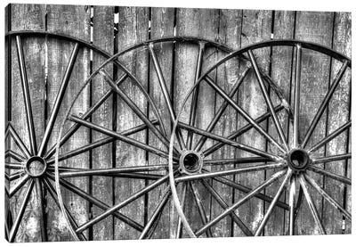 Wooden fence and old wagon wheels, Charleston, South Carolina Canvas Art Print