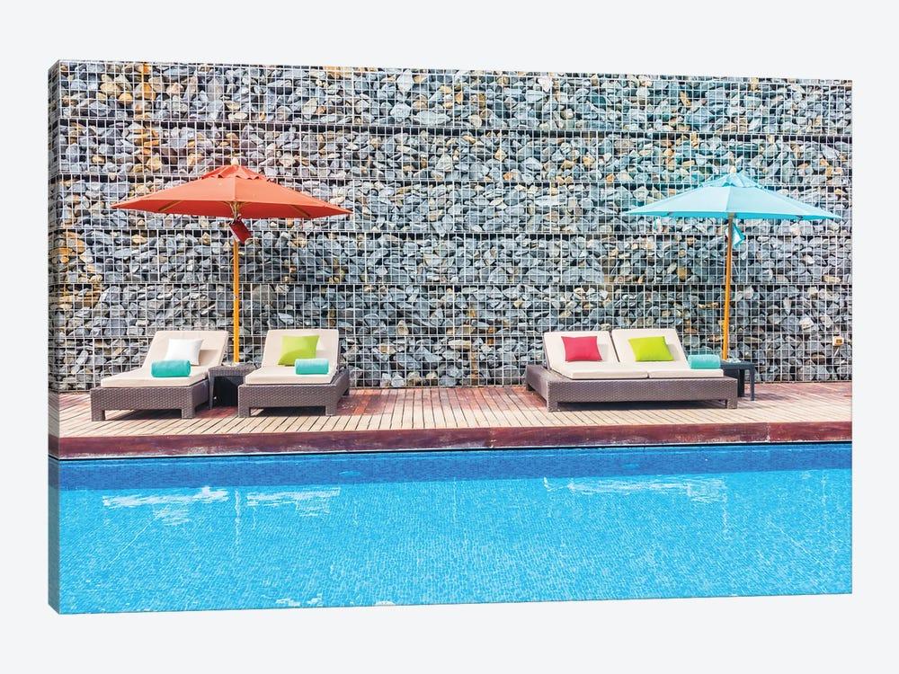Umbrella And Chair Around Swimming Pool by mrsiraphol 1-piece Canvas Art Print