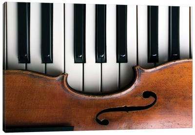 Old Violin On Piano Keys Canvas Art Print