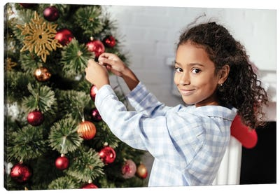 Adorable Child In Pajamas Decorating Christmas Tree With Baubles Canvas Art Print