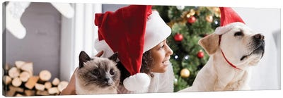 Smiling African American Girl In Santa Hat Near Labrador Dog And Fluffy Cat Canvas Art Print