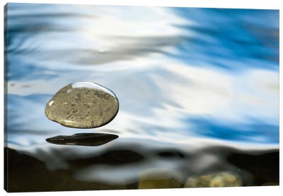 Skipping Stone Just About To Hit The Water's Surface Canvas Art Print