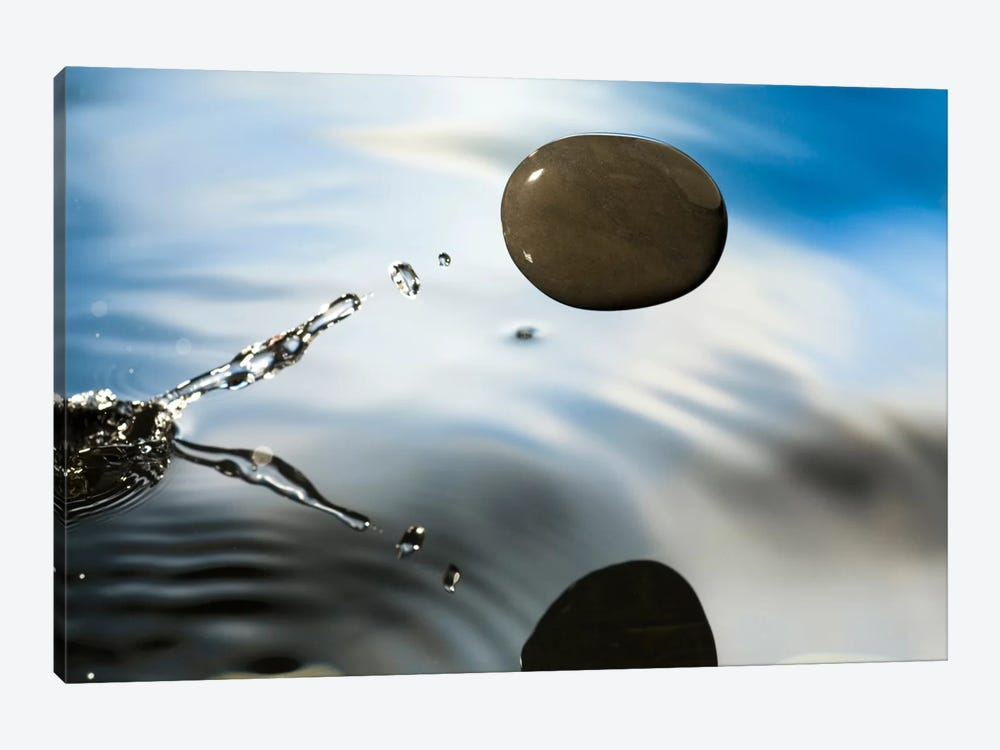 A Rock Skipping Across The Water's Surface by Michael Durham 1-piece Canvas Art Print