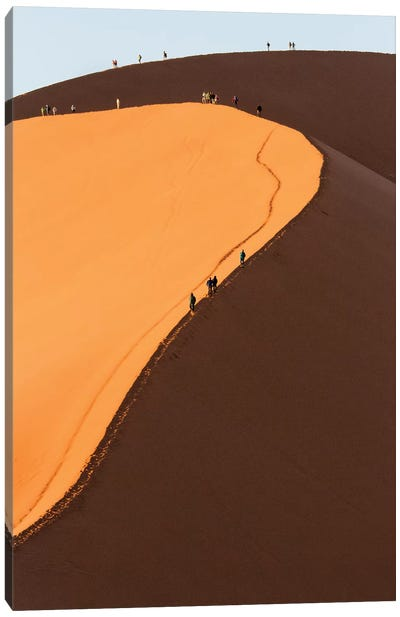 Africa, Namib Desert. Hikers climbing the red sand dune in Namibia. Canvas Art Print