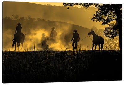 USA, California, Parkfield, V6 Ranch silhouette of riders, on horseback. Early dusty morning.  Canvas Art Print