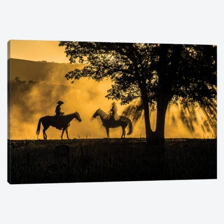 USA, California, Parkfield, V6 Ranch silhouette of two riders on horseback. Early dusty morning.  Canvas Print #ECL5} by Ellen Clark Canvas Art Print