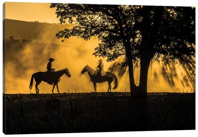 USA, California, Parkfield, V6 Ranch silhouette of two riders on horseback. Early dusty morning.  Canvas Art Print