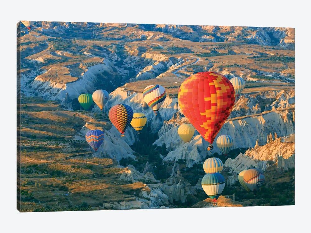 Turkey, Anatolia, Cappadocia, Goreme. Hot air balloons above Red Valley II by Emily Wilson 1-piece Canvas Wall Art
