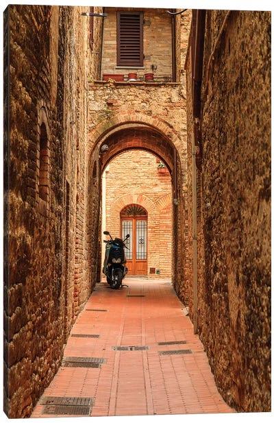 Italy, San Gimignano. Alleyway with motorbike. Canvas Art Print