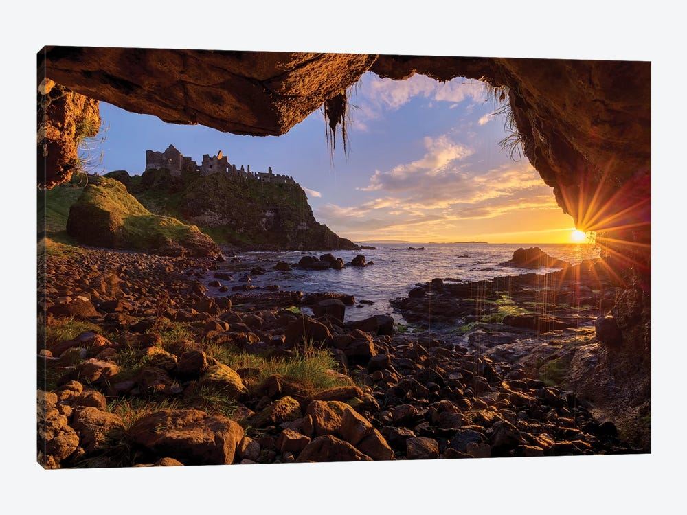 Cave Frames Sunset At Dunluce Castle, Causeway Coast, County Antrim, Northern Ireland by Gareth McCormack 1-piece Canvas Print