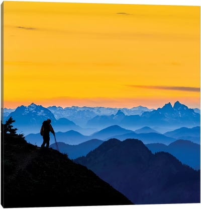 USA, Washington State. A backpacker descending from the Skyline Divide at sunset. Canvas Art Print