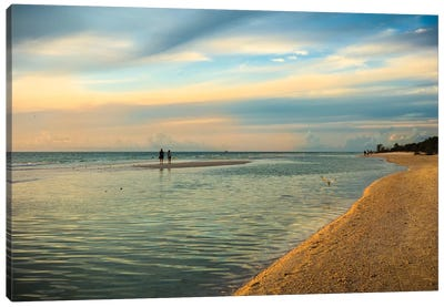 People standing on a sandbar in the water watching sunset Canvas Art Print