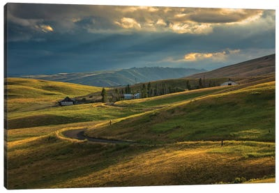 Ranch nestled in the rolling hills near Painted Hills, Oregon at sunset Canvas Art Print