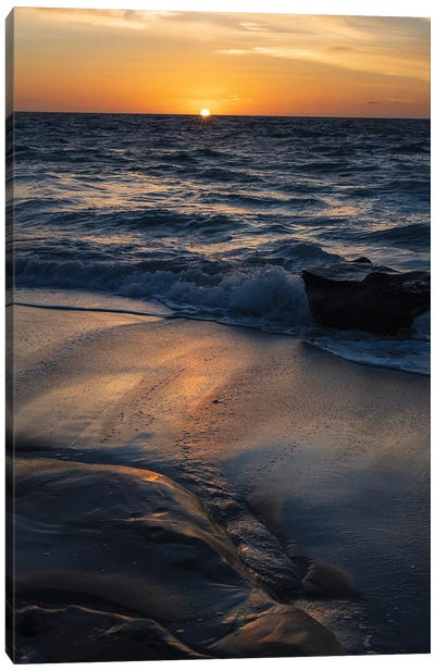 Sun setting on the Pacific Ocean with reflection of golden in the sand Canvas Art Print
