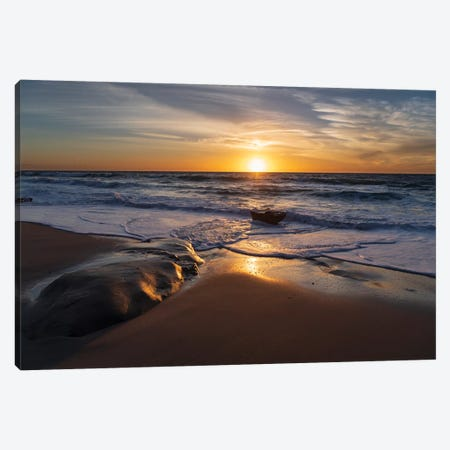 Sunset reflecting off the water on the sand of a beach Canvas Print #HDD17} by Sheila Haddad Canvas Print
