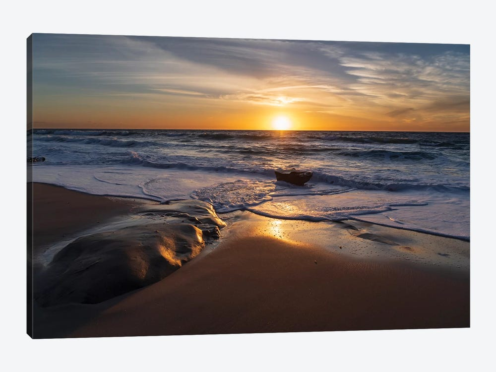 Sunset reflecting off the water on the sand of a beach by Sheila Haddad 1-piece Art Print