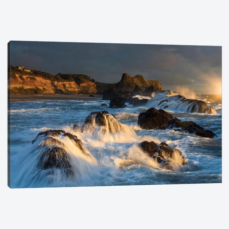 Waves crashing on rocks and washing down the sides at sunset Canvas Print #HDD19} by Sheila Haddad Canvas Wall Art